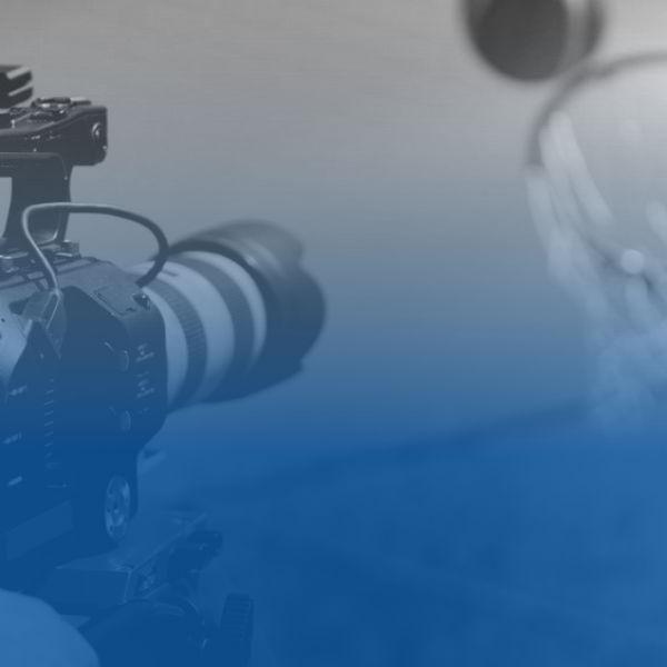 Video camera filming basketball shot